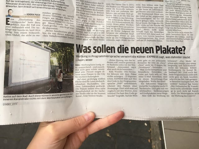 "German newspaper article with a photo of one of our billboards and the headline ""What are these billboards about?"